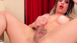 Hot shemale floozy jerks off her throbbing cock like avid
